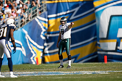Philadelphia Eagles punter Sav Rocca #6 points downfield during the NFL game between the Philadelphia Eagles and the San Diego Chargers on November 15th 2009. At Qualcomm Stadium in San Diego, California. (Photo By Brian Garfinkel)