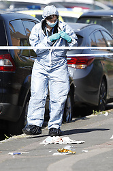© Licensed to London News Pictures. 11/06/2018. London, UK. A police forensics officer is seen where a 17 year old was critically injured in a stabbing in Harrow last night. Police are also dealing with a stabbing incident in nearby Northolt where a 20 year old was injured. Photo credit: Peter Macdiarmid/LNP