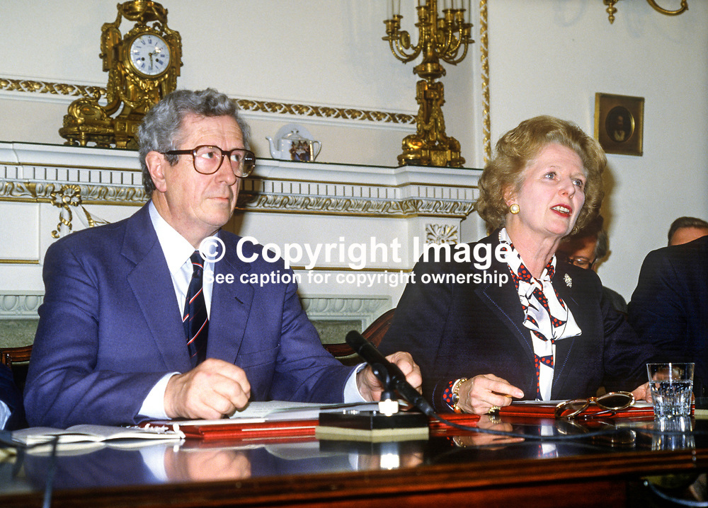 Press conference following signing of Anglo-Irish Agreement by Margaret Thatcher, Prime Minister, UK, and Garret Fitzgerald, Prime Minister, An Taoiseach, Rep of Ireland, at Hillsborough Castle, N Ireland, 15th November 1985. 1985111505c.<br /> <br /> Copyright Image from Victor Patterson, Belfast, UK<br /> <br /> t: +44 28 9066 1296 (from Rep of Ireland 048 9066 1296)<br /> m: +44 7802 353836<br /> e: victorpattersonbelfast@gmail.com<br /> <br /> www.images4media.com<br /> <br /> Please see my full Terms and Conditions of Use at https://www.images4media.com/p/terms-conditions - it is IMPORTANT that you familiarise yourself with them.<br /> <br /> Images used online incur an additional cost. This cost should be agreed in writing in advance. Online images must be visibly watermarked i.e. © Victor Patterson or that of the named photographer within the body of the image. The original metadata must not be deleted from images used online.<br /> <br /> This image is only available for the use of the download recipient i.e. television station, newspaper, magazine, book publisher, etc, and must not be passed on to a third party. It is also downloaded on condition that each and every usage is notified within 7 days to victorpattersonbelfast@gmail.com.<br /> <br /> The right of Victor Patterson (or the named photographer) to be identified as the author is asserted in accordance with The Copyright Designs And Patents Act (1988). All moral rights are asserted.