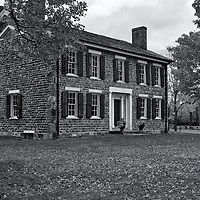 """""""Cobblestone Farm in Fall"""" B&W<br /> <br /> Cobblestone Farm is a beautiful historic home and farm located in Ann Arbor Michigan. The lovely stone work on this home is gorgeous anytime of the year, whether in color or black and white. This scene is set during autumn with lovely Maple trees surrounding it with their foliage!!<br /> <br /> Black and White images by Rachel Cohen"""