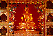 The Buddha seen as part of a shrine in the prayer room of Kagyu Samye Ling Buddhist retreat centre