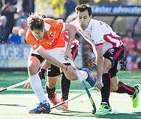 BLOEMENDAAL - HOCKEY -  De Duitser Florian Fuchs (Bl'daal) met  rechts Niek van der Schoot (Oranje-Rood)   tijdens de competitie hoofdklasse hockeywedstrijd Bloemendaal -ORANJE-ROOD (4-1)  COPYRIGHT KOEN SUYK