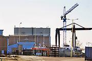 Nederland, Millingen aan de Rijn, 27-2-2019 Scheepswerf Bodewes is na jarenlang gesloten te zijn geweest overgenomen door scheepswerf Gelria en is nu weer in bedrijf. Er wordt voornamelijk onderhoud aan binnenvaartschepen gedaan . Constructiebedrijf . Foto: Flip Franssen