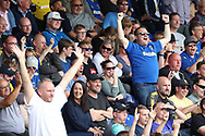 AFC Wimbledon football fans, football supporters celebrating during the EFL Sky Bet League 1 match between AFC Wimbledon and Scunthorpe United at the Cherry Red Records Stadium, Kingston, England on 15 September 2018.