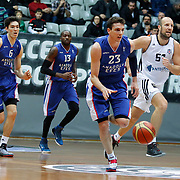 Besiktas integral Forex's Kenan Bajramovic (R) Anadolu Efes's Matthew Janning (2ndR) during their Turkish basketball league match Besiktas integral Forex between Anadolu Efes at BJK Akatlar Arena in Istanbul, Turkey, Monday, January 05, 2015. Photo by TURKPIX
