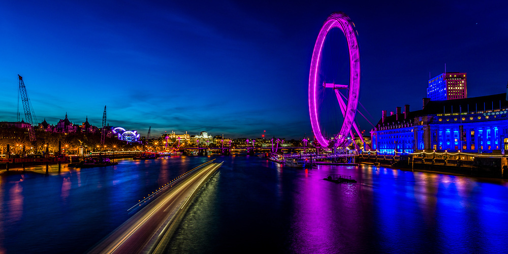 Long exposure image of the London Eye taken from the Westminster Bridge during the Blue Hour