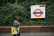 A woman walks along the platform at Dlaston Kingsland station 28th July 2016, London, United Kingdom.