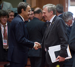 Jose Zapatero, Spain's prime minister, left, speaks with Yves Leterme, Belgium's prime minister, during the European Summit meeting at EU Council headquarters in Brussels, Belgium, on Thursday, June 17, 2010. (Photo © Jock Fistick)