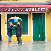 Two men talk in the flooded  main square of Burano More than 59% of Venice was under water on Thursday, as the historic lagoon town was hit by exceptionally high tides. The sea level rose above 140cm overnight and was expected to remain above critical levels for about 15 hours.