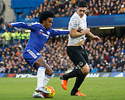 Everton midfielder Gareth Barry holds on to Chelsea attacker Willian during the Barclays Premier League match between Chelsea and Everton at Stamford Bridge, London, England on 16 January 2016. Photo by Andy Walter.