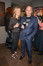 PEREGRINE & CAROLINE ARMSTRONG-JONES at a private view of paintings by Michael Flatley entitled Firedance held at 12 hay Hill, London on 24th June 2015.