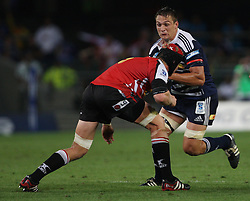 Rynhardt Elstadt takes on the defense during the Super Rugby (Super 15) fixture between the DHL Stormers and the Lions held at DHL Newlands Stadium in Cape Town, South Africa on 26 February 2011. Photo by Jacques Rossouw/SPORTZPICS