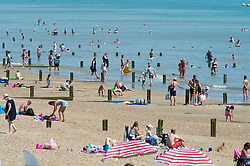 ©Licensed to London News Pictures 07/08/2020   Dymchurch, UK. Sun worshippers in the sea at Dymchurch in Kent on the south coast. Scorching hot weather today in the UK as the heatwave weather looks set to continue into next week. Today could be one of the hottest on record if not the hottest. Photo credit: Grant Falvey/LNP