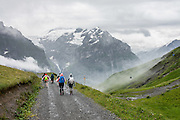 Hike from First gondola lift station above Grindelwald, across Grosse Sheidegg pass, then walk down to Rosenlaui PostBus station for a ride to Meiringen. Switzerland, the Alps, Europe.