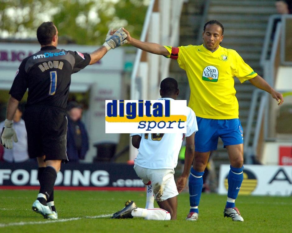 Photo: Ed Godden.<br /> Milton Keynes Dons v Hereford United. Coca Cola Championship. 21/10/2006. Hereford's keeper Wayne Brown and Hereford captain, Tamika Mkandawire congratulate each other after some good defending.