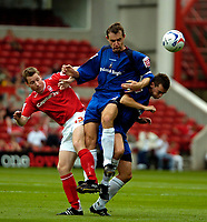 Photo: Ed Godden.<br />Nottingham Forest v Bradford City. Coca Cola League 1.<br />05/08/2006. L-R Forest's Neil Harris, David Wetherall and Steven Schumacher of Bradford.