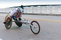 MIAMI, FL - JANUARY 30: Competitor Orlando Cortes, racing in  wheekchair during the Miami Marathon. January 30, 2011 in Miami, Florida.