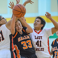 Gallup JV Bengal Samantha Quigley (33) fights a rebound away from Crownpoint Eagles Tia Charley (41) and Rodera Johnson (31) Friday at Wingate High School.