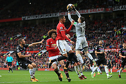 30th September 2017 - Premier League - Manchester United v Crystal Palace - Palace goalkeeper Wayne Hennessey catches the ball ahead of Chris Smalling of Man Utd (C) and Marouane Fellaini of Man Utd - Photo: Simon Stacpoole / Offside.