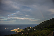 A rainbow is seen on the Costa Concordia one day before the removal