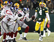 Green Bay Packers' Brett Favre after his pass in overtime was intercepted by New York Giants' Corey Webster and returned to the Green Bay 43-yard line. .The Green Bay Packers hosted the New York Giants in the NFC Championship game  Sunday January 20, 2008. Steve Apps-State Journal.