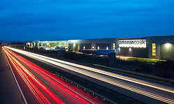 View of Amazon distribution warehouse centre in Dunfermline, Fife, Scotland night