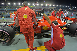 SINGAPORE, Sept. 15, 2018  Ferrari driver Sebastian Vettel of Germany stops at the pit building after his car springs a leak in the second practise session of the Formula One Singapore Grand Prix Night Race held at the Marina Bay Street Circuit on Sept. 14, 2018. (Credit Image: © Then Chih Wey/Xinhua via ZUMA Wire)