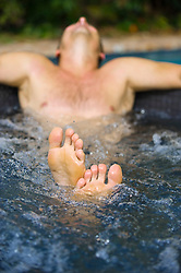 detail of a man in a hot tub with soft focus on his body