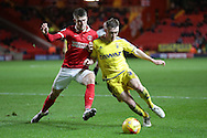 Johann Guomundsson of Charlton Athletic tussles with Ben Osborn of Nottingham Forest. Skybet football league championship match, Charlton Athletic v Nottingham Forest at The Valley  in London on Saturday 2nd January 2016.<br /> pic by John Patrick Fletcher, Andrew Orchard sports photography.