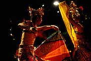 Young man and woman performing traditional Balinese Legong dance. Sanur, Bali, Indonesia.