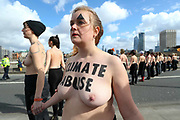 31 women form a topless protest chain on Waterloo Bridge on International Women's Day in central London on Sunday, Mar. 8, 2020. (Photo/Vudi Xhymshiti)