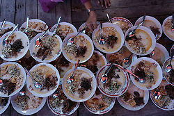 June 16, 2017 - Yogyakarta, Indonesia - Indonesian Muslims prepare porridge for break fasting at Sabilurrosyad Mosque, Yogyakarta, Indonesia on June 16, 2017. This place has a tradition to break the fast by eating porridge. During the month of Ramadan, Sabilurrosyad mosque provide food menu porridge made from rice and coconut milk for break fasting. (Credit Image: © Nugroho Hadi Santoso/NurPhoto via ZUMA Press)