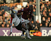 Photo: Lee Earle.<br /> Fulham v Arsenal. The Barclays Premiership. 04/03/2006. Fulham's Luis Boa Morte (L) battles with Abou Diaby.