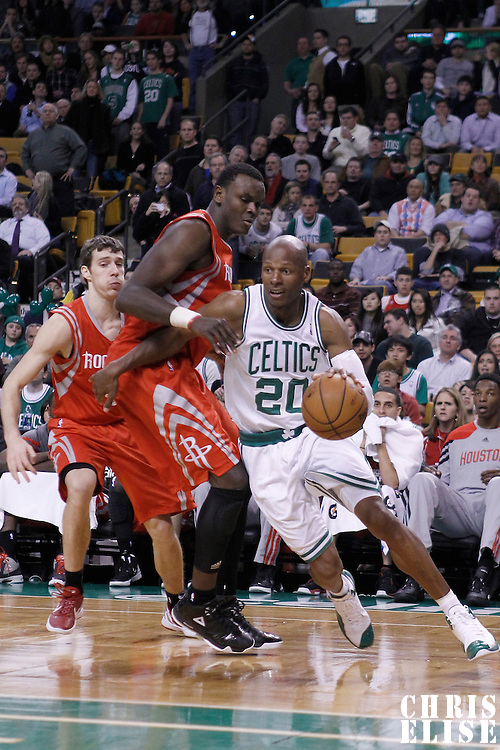 06 March 2012: Boston Celtics shooting guard Ray Allen (20) drives past Houston Rockets center Samuel Dalembert (21) during the Boston Celtics 97-92 (OT) victory over the Houston Rockets at the TD Garden, Boston, Massachusetts, USA.