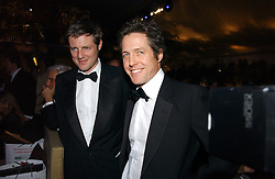 Left to right, ZAC GOLDSMITH and HUGH GRANT at the British Red Cross London Ball held at The Room by The River, 99 Upper Ground, London SE1 on 16th November 2006.<br /><br />NON EXCLUSIVE - WORLD RIGHTS