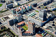 Nederland, Noord-Holland, Zaandam, 20-04-2015; Inverdan, nieuwe stadscentrum Zaandam, masterplan Sjoerd Soeters. Station en Stadhuis boven in beeld. Naast het station het Zaanse huisjeshotel - Inntel Hotel - is een ontwerp Wilfried van Winden.<br /> New center of the city of Zaandam, developed according to the master plan by architect Sjoerd Soeters. Train station and city hall. The hotel built in a postmodern version of the style of the historic houses of Zaandam - Inntel Hotel - was designed by Wilfried van Winden.<br /> luchtfoto (toeslag op standard tarieven);<br /> aerial photo (additional fee required);<br /> copyright foto/photo Siebe Swart