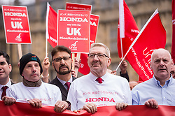 © Licensed to London News Pictures. 06/03/2019. LONDON, UK.  Len McCluskey (2R), General Secretary of Unite, joins workers from Honda's Swindon plant during a demonstration outside the Houses of Parliament calling on MPs to save their factory from closing.  Honda recently announced that the plant will cease production in 2022 amidst uncertainty over the future post-Brexit.  Photo credit: Stephen Chung/LNP