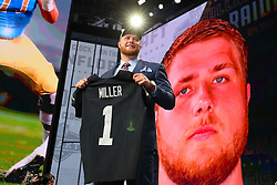 April 26, 2018 - Arlington, TX, U.S. - ARLINGTON, TX - APRIL 26:  Kolton Miller holds up a jersey and takes a photo after being chosen by the Oakland Raiders with the fifteenth pick during the first round at the 2018 NFL Draft at AT&T Statium on April 26, 2018 at AT&T Stadium in Arlington Texas.  (Photo by Rich Graessle/Icon Sportswire) (Credit Image: © Rich Graessle/Icon SMI via ZUMA Press)