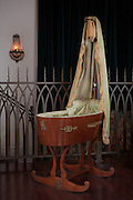A bassinet that once belonged to Napoleon III, and was used by his son inside Gertrude Zachary's guest house in downtown Albuquerque New Mexico...CREDIT: Steven St. John for The Wall Street Journal