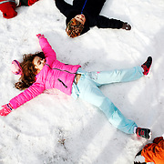 St. Gregory the Great Catholic School kindergarten student Sophia Taylor,   makes a snow angel during the annual Snow Day event at St. Gregory the Great Catholic School on February 10, 2014.
