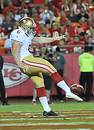 KANSAS CITY, MO - AUGUST 16:  Punter Colton Schmidt #6 of the San Francisco 49ers punts the ball down the field against the Kansas City Chiefs during the first half on August 16, 2013 at Arrowhead Stadium in Kansas City, Missouri.  (Photo by Peter G. Aiken/Getty Images) *** Local Caption *** Colton Schmidt