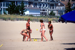 """A quartet of unidentified women play """"spikeball"""" at North Shores, Monday, Aug. 19, 2019 in Rehoboth Beach, Del. (Photo by D. Ross Cameron)"""