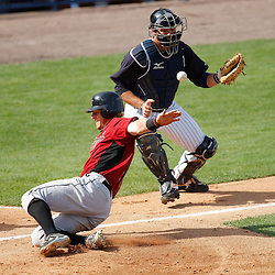 March 2, 2011; Tampa, FL, USA; Houston Astros catcher J.R. Towles (46) slides past New York Yankees catcher Austin Romine (84) scoring a run during a spring training exhibition game at George M. Steinbrenner Field.  Mandatory Credit: Derick E. Hingle