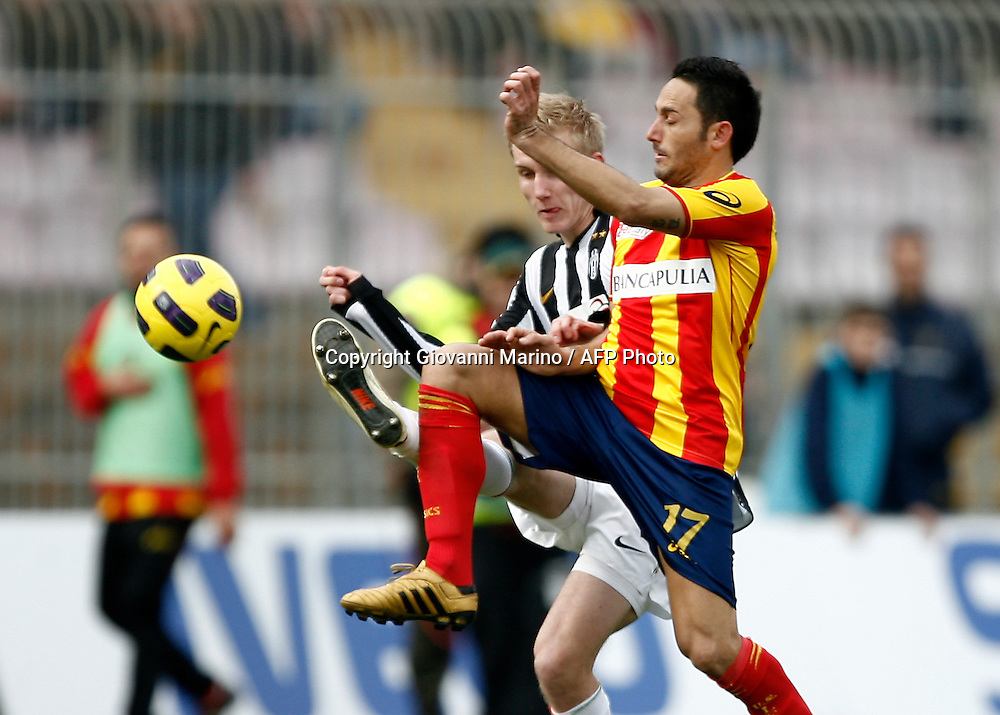 ITALY, Lecce :Sorensen J Di Michele L during the Serie A match between Lecce and Juventus at Stadio Via del Mare in Lecce on February 20, 2011. .AFP PHOTO / GIOVANNI MARINO