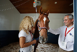 Poespass of Boulanger Karin (BEL) at the clinic in the Kentucky Horse Park recovering well after a colic operation visited by chef de mission Ingmar Devos<br /> World Equestrian Games Lexington - Kentucky 2010<br /> © Dirk Caremans