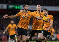 Football - 2019 / 2020 Premier League - Arsenal vs. Wolverhampton Wanderers<br /> <br /> Raul Jimenez (Wolverhampton Wanderers), Diogo Jota (Wolverhampton Wanderers) and Ruben Vinagre (Wolverhampton Wanderers) celebrate after scoring their teams equaliser at The Emirates Stadium.<br /> <br /> COLORSPORT/DANIEL BEARHAM