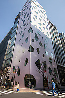 Ginza Mikimoto Building - Ginza is known as an upscale area of Tokyo with numerous department stores, boutiques, restaurants and is recognized as one of the most luxurious shopping districts in the world. Many upscale fashion flagship stores are located here, including Chanel, Dior, Gucci, Louis Vuitton....  In recent years extraordinary architecture has gone up including the De Beers Building, Mikimoto Building among others.  Ginza is named after the silver-coin mint established there in 1612 during the Edo period..