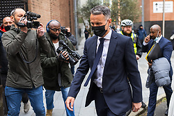 © Licensed to London News Pictures. 28/04/2021. Manchester, UK. RYAN GIGGS leaves Manchester and Salford Magistrates Court after his first appearance in court . The former Manchester United footballer and Wales manager has been charged with causing actual bodily harm to a woman in her 30s and common assault of a woman in her 20s in relation to incidents that took place on the evening of Sunday 1st November 2020 and has further been charged with one count of coercive and of controlling behaviour between December 2017 and November 2020 Photo credit: Joel Goodman/LNP