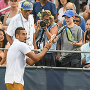 NICK KYRGIOS gives a fan his broken racket at the Rock Creek Tennis Center.