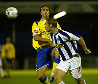 Fotball<br /> England 2005/2006<br /> Foto: SBI/Digitalsport<br /> NORWAY ONLY<br /> <br /> Colchester United v Cardiff City. Carling Cup.<br /> 24/08/2005.<br /> Andrea Ferretti of Cardiff is dispossessed by Liam Chilvers of Colchester